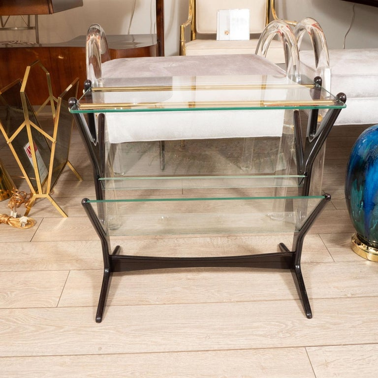 Mid-Century Modern Ebonized Wood and Glass Side Table / Magazine Rack For Sale