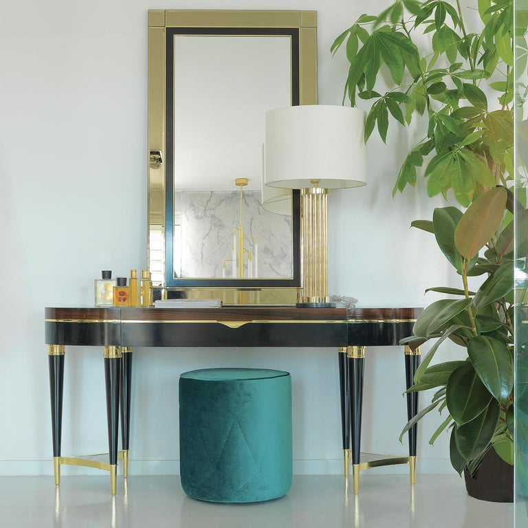 Part of a collection of exquisite furniture pieces made of ebony and boasting a bold character and timeless sophistication, this console features six legs painted in dark ebony, combined three by three, and connected with an insert in Corteccia