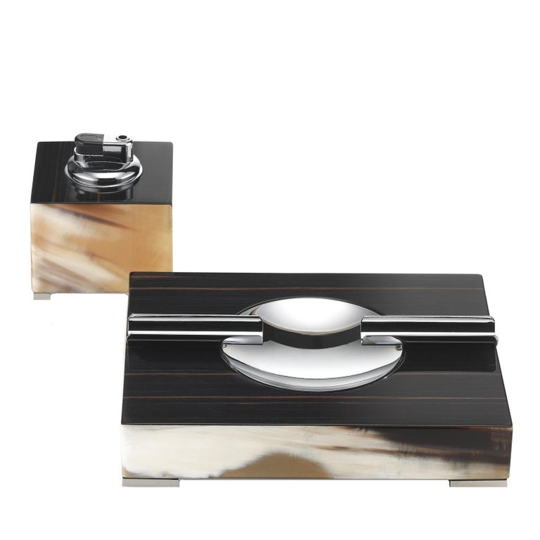 A dramatic accent to any modern living room decor, this square lighter and ash tray set will elevate any coffee table or desk surface with its timeless allure. Modern-inspired with a touch of vintage flair, this set boasts a striking combination of