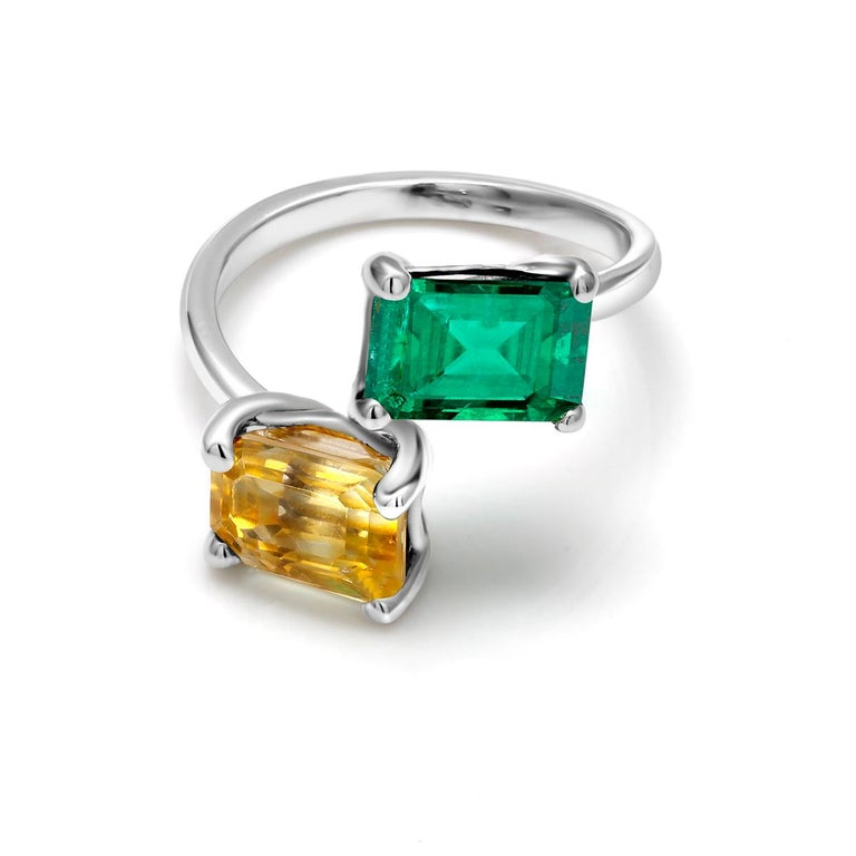 18 karat two tone white and yellow Open shank cocktail ring Emerald cut emerald weighing 1.25 carat   Emerald cut yellow sapphire weighing 2.86 carat                                                                     Ring size 6.5 In Stock Ring can