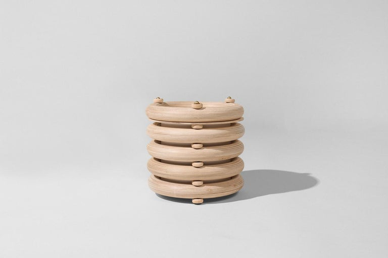 The Echo family of sculptural totems pairs tropical warmth with minimalist appeal. Made of stacked finely finished birch, the totems have an architectural rigidity and a soft visual appeal. The Echo Totem lights are the same sculpture as the