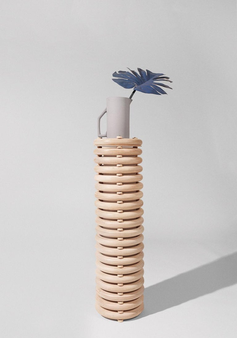 Made to order. Please allow six weeks for production.  The Echo family of sculptural totems pairs tropical warmth with minimalist appeal. Made of stacked finely finished birch, the totems have an architectural rigidity and a soft visual appeal.