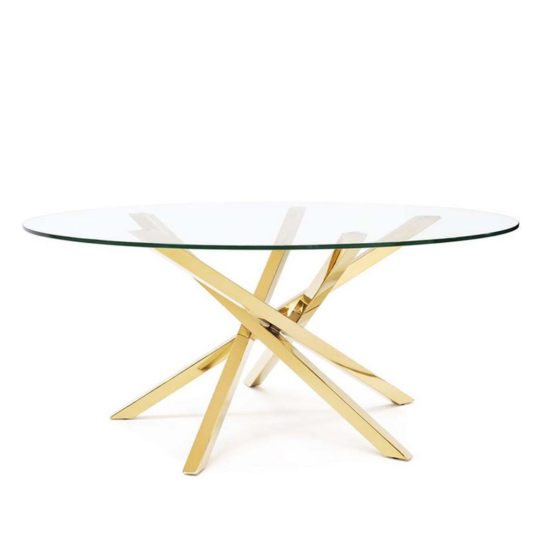 Coffee table eclipse with base in metal in gold finish. With round clear glass top. Also available in side table.