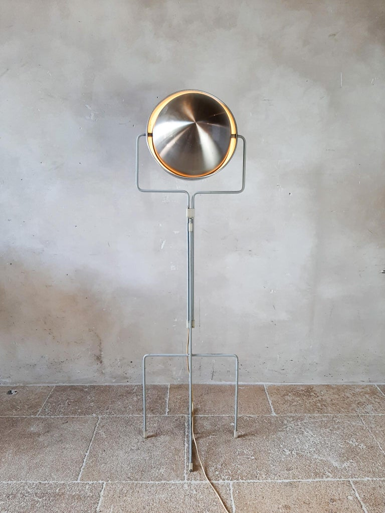 Dutch Modernist floor lamp designed by Architect E.J. Jelles for RAAK Amsterdam, Holland, 1960s. This designer floor lamp has a grey painted symmetrical base which is adjustable in height. The shade can be turned into many different positions making