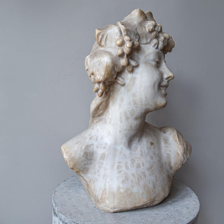 A stunning, sensual and timeless bust of a reveller of Dionysus. Of good scale proportion, beautifully hand carved out of alabaster and now showing an incredible aged patination.   Jef Lambeaux (1852-1908) was a leading Belgian figurative sculptor