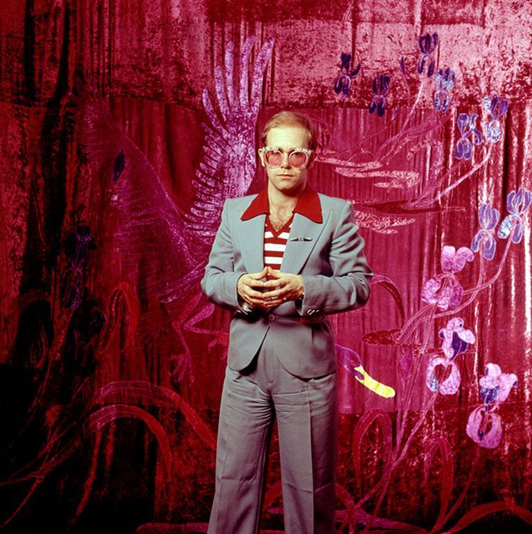 Elton John, 1974 (Ed Caraeff - Colour Photography) - Red Color Photograph by Ed Caraeff