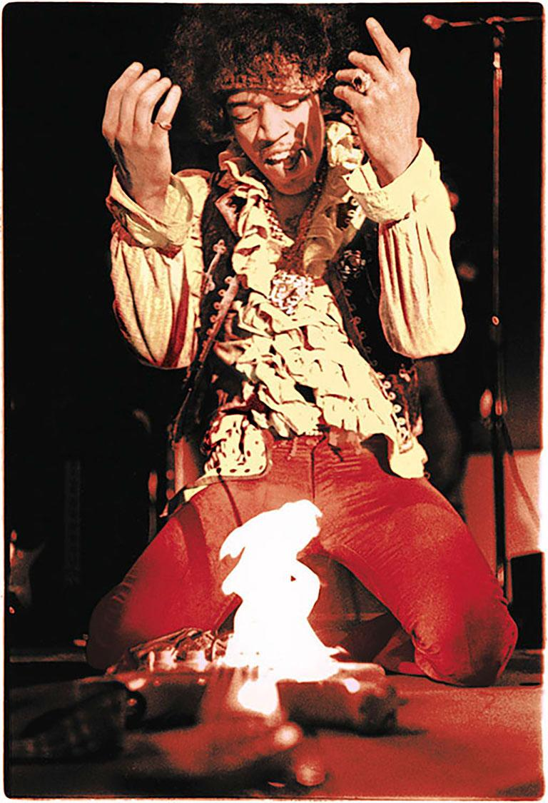 Hendrix At Monterey, 1967 (Ed Caraeff - Colour Photography) - Black Color Photograph by Ed Caraeff