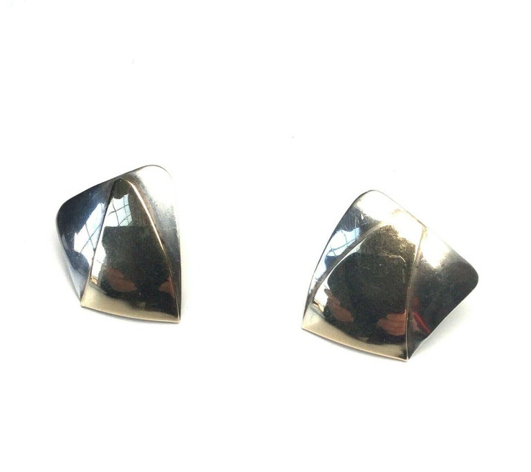 This is an amazing pair of 14K gold and sterling silver modernist earrings designed by Ed Levin.  Measurement:  20mm x 18mm, measures front to back with post 10 mm.   Weight:  6.4  g /  4.1 dwt  Condition:  In good condition with some surface