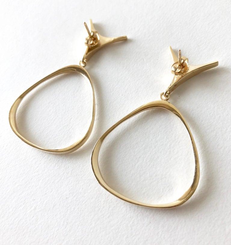 1950's abstract modernist 14k gold pierced earrings created by Ed Wiener of New York, New York.  Earrings measure 2 1/8