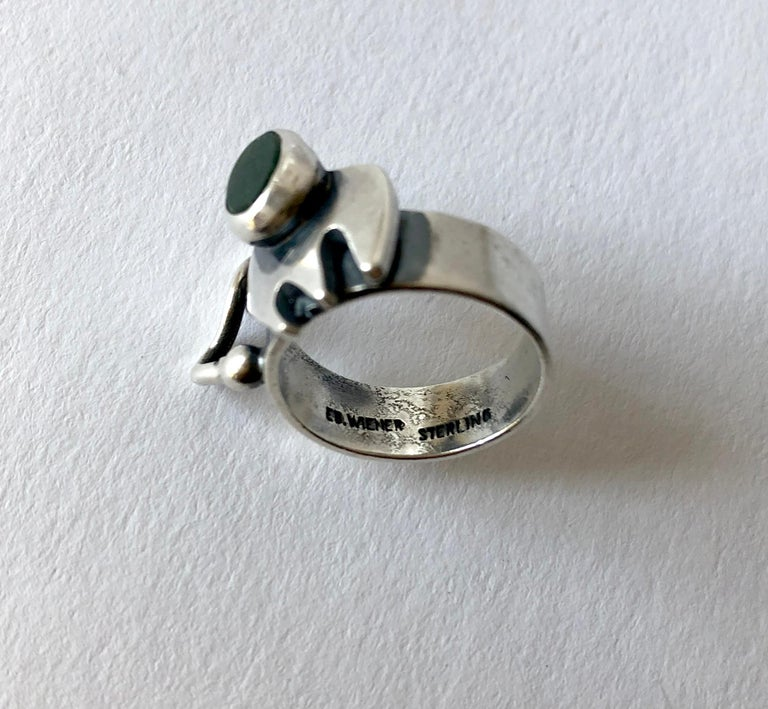 American modernist sterling silver and bloodstone ring created by Ed Wiener of New York, New York.  Ring is a finger size 6 and is signed Ed. Wiener, Sterling.  In very good vintage condition.