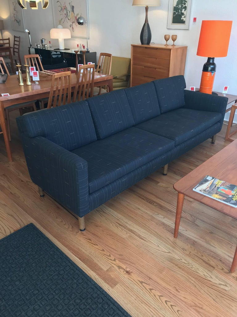 This handsome sofa, designed for Dunbar by Ed Wormley, has been reupholstered in a light black/charcoal Maharam fabric with fine attention to detail.  Zippered cushions remove to reveal a button-tufted back.  Model 5138, circa 1950s.  Poly/cotton