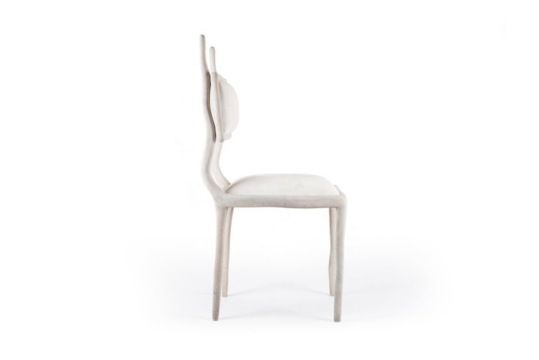 The Eden Chair in cream shagreen and upholstered in cream calf-hair adds the perfect balance between fantasy and modernity to any space. This chair can be used as an entrance piece accent or dramatized around a dining room table. The shagreen is