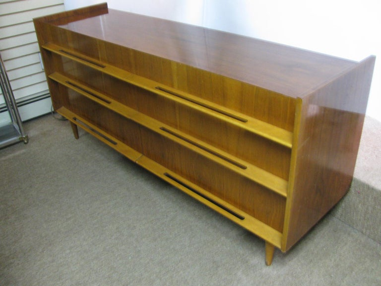 Beautiful, long elegant dresser by Edmond J. Spence. Six-drawer dresser in walnut with birch pulls, handles. Exceptionally clean and well designed, dovetailed case and bevelled top edge to the drawers, a well taken care of piece of furniture.