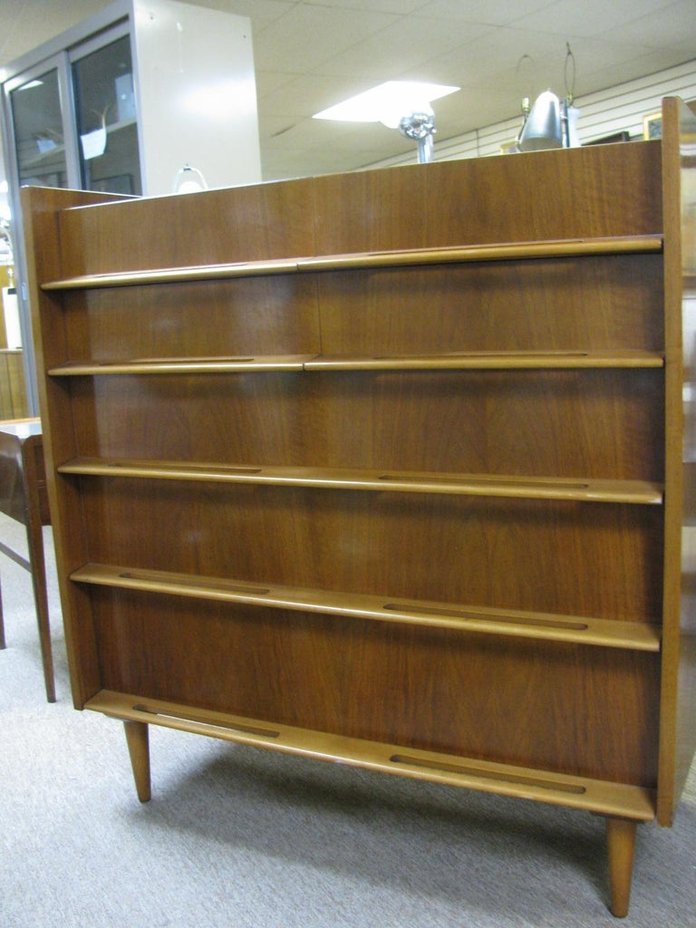Fabulous tall walnut dresser by Edmond Spence. Created out of walnut with birch pulls. In excellent vintage condition, was well cared for. Four drawers over three large drawers. Excellent construction methods with the case being dovetailed and the