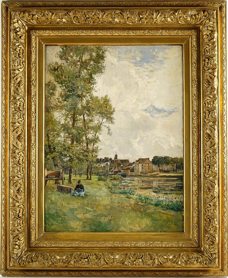 Edmond Yon, a seated woman by a River Loing, Oil on canvas, circa 1880-1890  A beautiful and decorative painting depicting a woman seating in a rural landscape the edge of the river Loing at the bottom the village of Moret sur Loing. An excellent