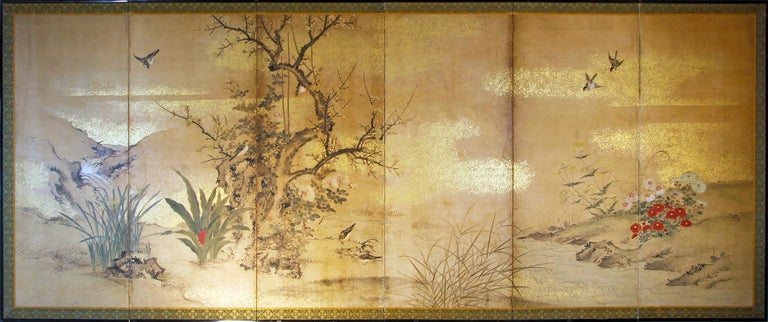 Landscape with birds, blooming sakura trees and chrysanthemum plants.