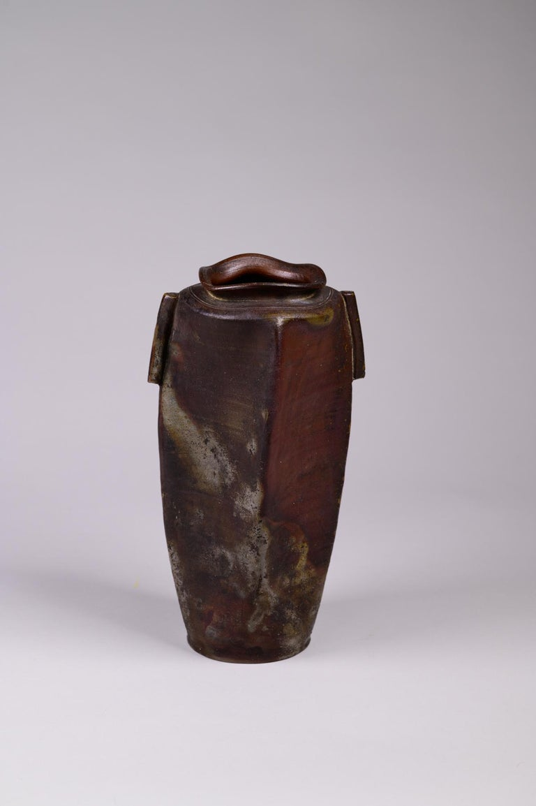 Edo period Bizen vase, late Edo period (mid-19th century) ceramic vase from Bizen, one of the six ancient kilns in Japan. Unusual undulating rim, with traditional potter's marks around the top. Beautiful natural glaze and interesting
