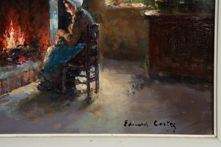 A beautifully painted oil on canvas by French impressionist painter Edouard Leon Cortes depicting a Breton interior with a woman seated in front of an open fire sewing. Signed lower right.   The work has been authenticated by Mme. Nicole Verdier and