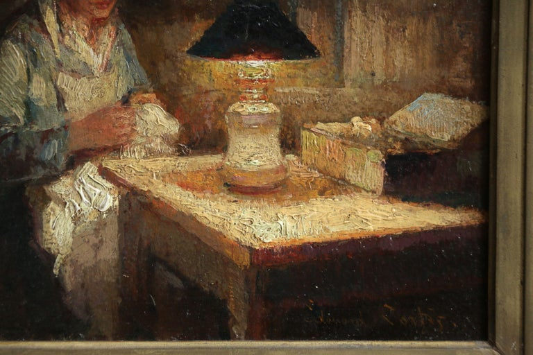 A stunning oil on panel circa 1910 by sought after French impressionist painter, Edouard Leon Cortes depicting a Breton woman seated at a table darning clothes by the light of an oil lamp. The contrast of the light and shadow is beautifully