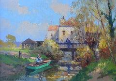 Man Fishing in Row Boat near Village, House, Bridge, Normandie, France,