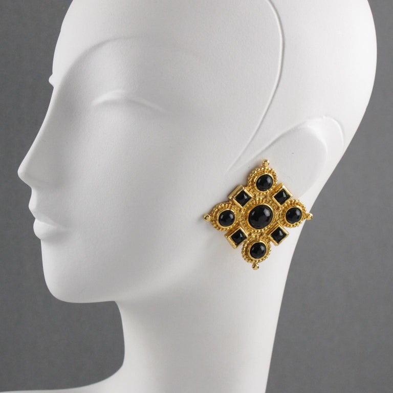 Stunning oversized Edouard Rambaud Paris signed clip-on earrings. Byzantine revival inspired design with a gilt metal square shape all textured topped with resin and glass cabochons in true licorice black color. Signed underside: