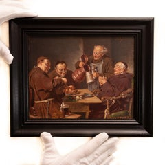 Monks around a table by a follower of Eduard von Grützner, oil on panel