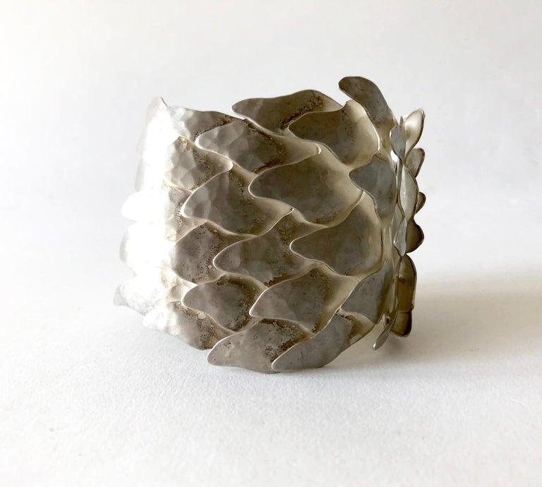 Undulating silver Scales bracelet by Mexican architect turned jeweler, Eduardo Herrera. The numerous overlapping matte finish links give the bracelet a surprising fluidity, given its size. It is very comfortable to wear. The bracelet is 2 1/2