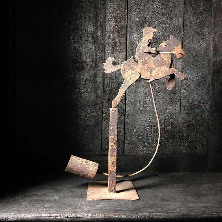 This toy was originally designed by LOUIS C. PETERSEN. He was Director of Manual Arts, State Normal University, Carbondale, Illinois. Since then many fathers and boys have created one of his many designs. This toy is from the 20's.