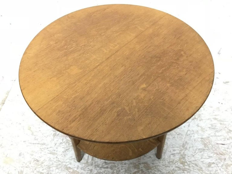 Edward Barnsley. A handmade Arts & Crafts oak two tier circular coffee or side table. Stamped 'Barnsley' underneath in two places.
