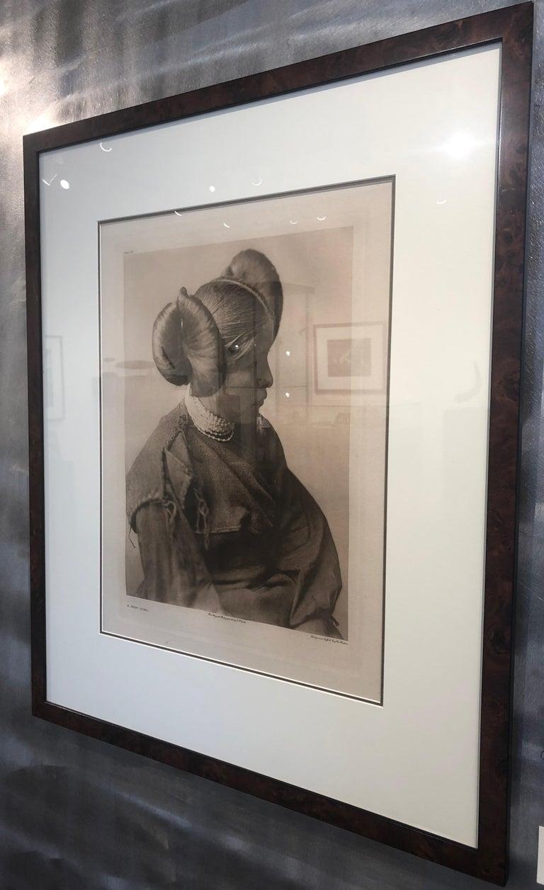 Edward Curtis, A Hopi Girl, Plate 406,  Photogravure on Holland Van Gelder paper - Brown Portrait Photograph by Edward Curtis