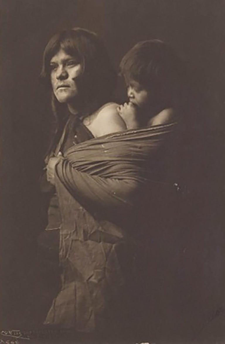 "Edward Curtis. A Hopi Mother, Plate 403, Photogravure on Holland Van Gelder.  Plate 406. Paper size 22 x 18"". Typed artist name, dated, and titled on print recto.  In the early 20th century, Edward S. Curtis photographed and documented over eighty"