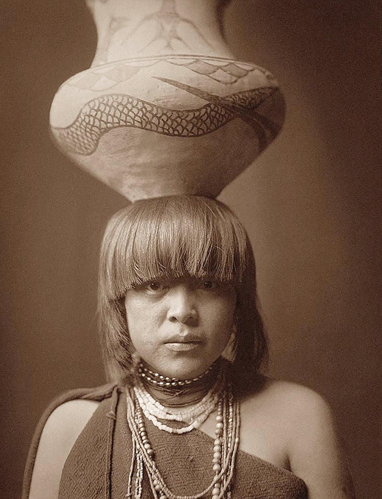 Edward Curtis, Girl and Jar Portrait, San Ildefonso Pueblo, Photogravure - Photograph by Edward Curtis