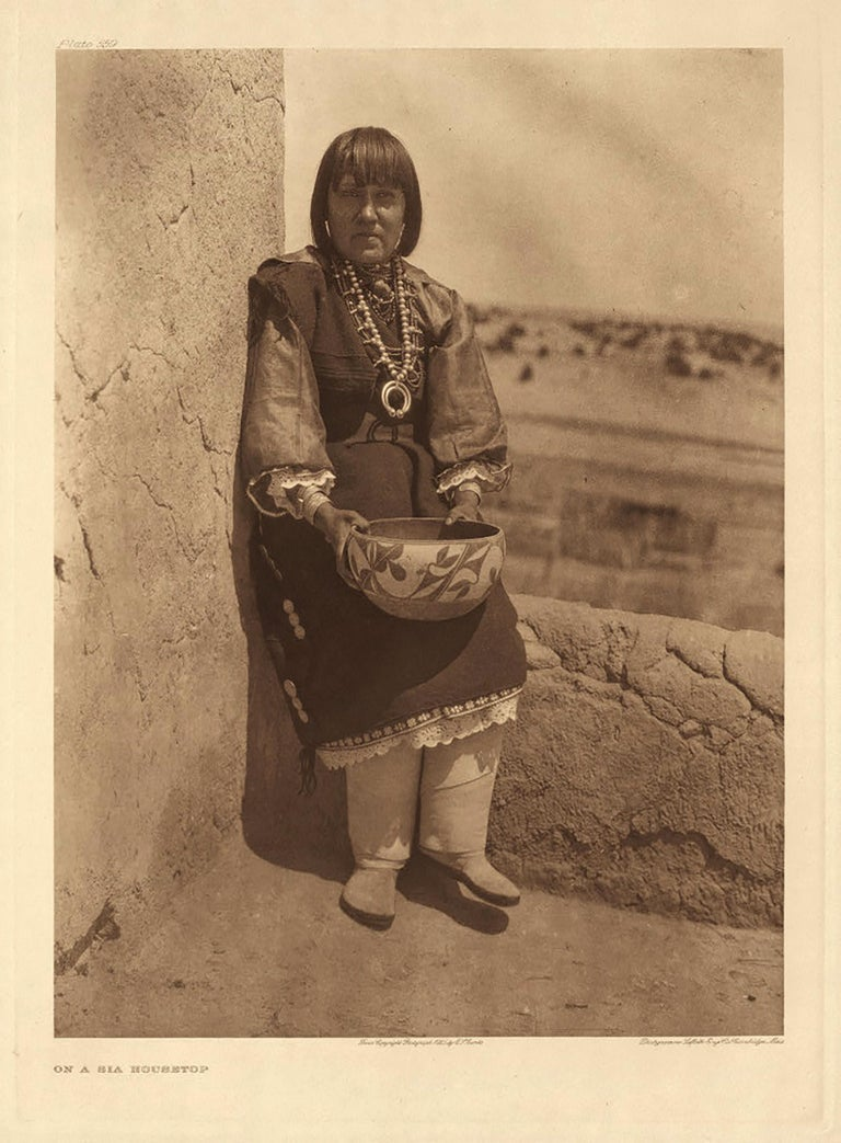 Edward Curtis, On a Sia Housetop, 1925,Plate 559, Photogravure from Portfolio16  - Photograph by Edward Curtis