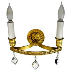 Edward F. Caldwell Brass Sconce with Wind God Design