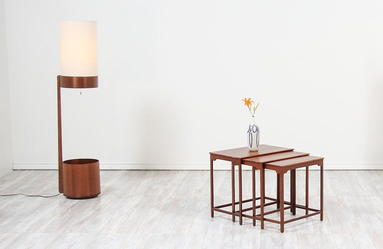 Set of three nesting tables designed by Edward J. Wormley for Dunbar in the United States in 1947. This set of three tables model #4785 is made of solid walnut wood with darker walnut frames and a lighter top for a stylish wood contrast. The design