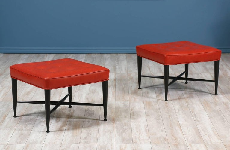 "A pair of red leather ""Thebes"" stools designed by Edward J. Wormley for Dunbar in the United States circa 1950's. Its comfortable and stylish cushions are reupholstered in high quality red grain leather with button tufting detail and rest on a newly"