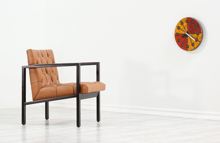 Mid-Century Modern lounge chair designed by American furniture designer, Edward J. Wormley, for Dunbar in the United States, circa 1950s. This Classic lounge chair is reupholstered in a beautiful full-grain tan leather with a diamond tufted pattern.