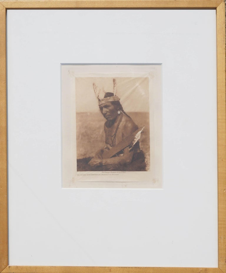 Early 20th Century Photogravure of Blackfoot Soldier -- Fat Horse  - Photograph by Edward Sheriff Curtis