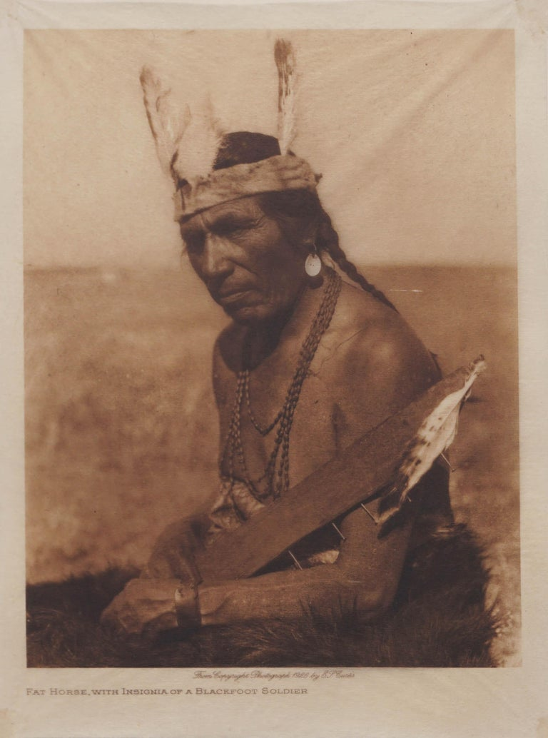 Edward Sheriff Curtis Figurative Photograph - Early 20th Century Photogravure of Blackfoot Soldier -- Fat Horse