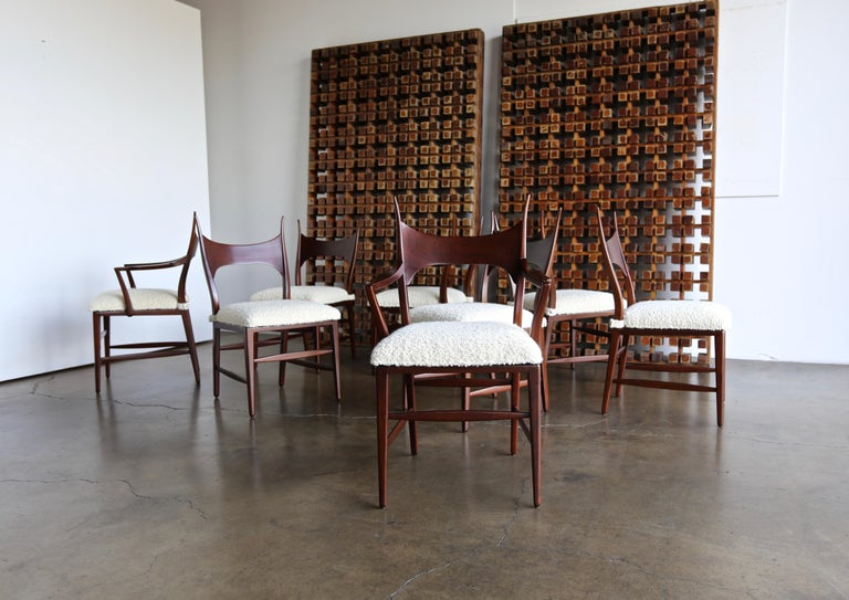 Rare set of eight Edward Wormley 5580 dining chairs for Dunbar, 1950s. Bouclé seat pads over cane seats.  The armchairs measure: 23.13