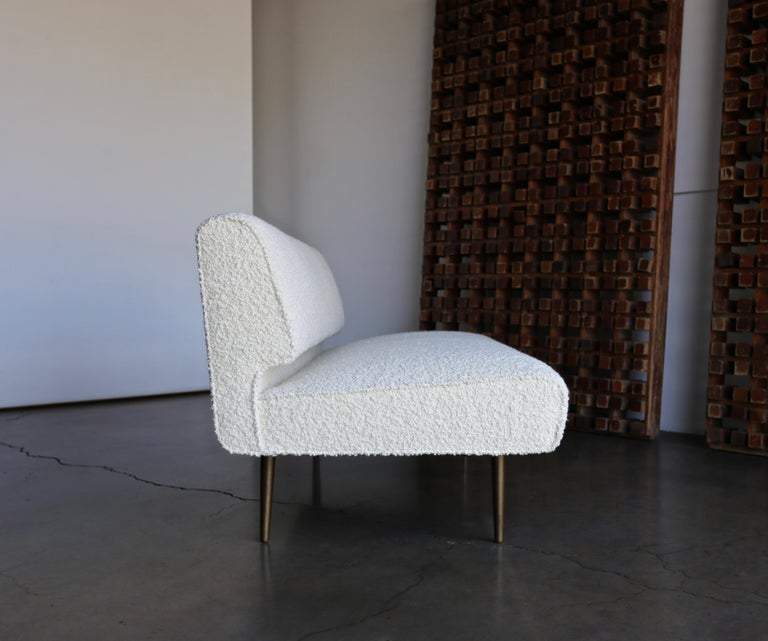 Edward Wormley armless sofa for Dunbar, circa 1955. This piece has been expertly restored in alpaca bouclé. Original patina to the solid brass legs.