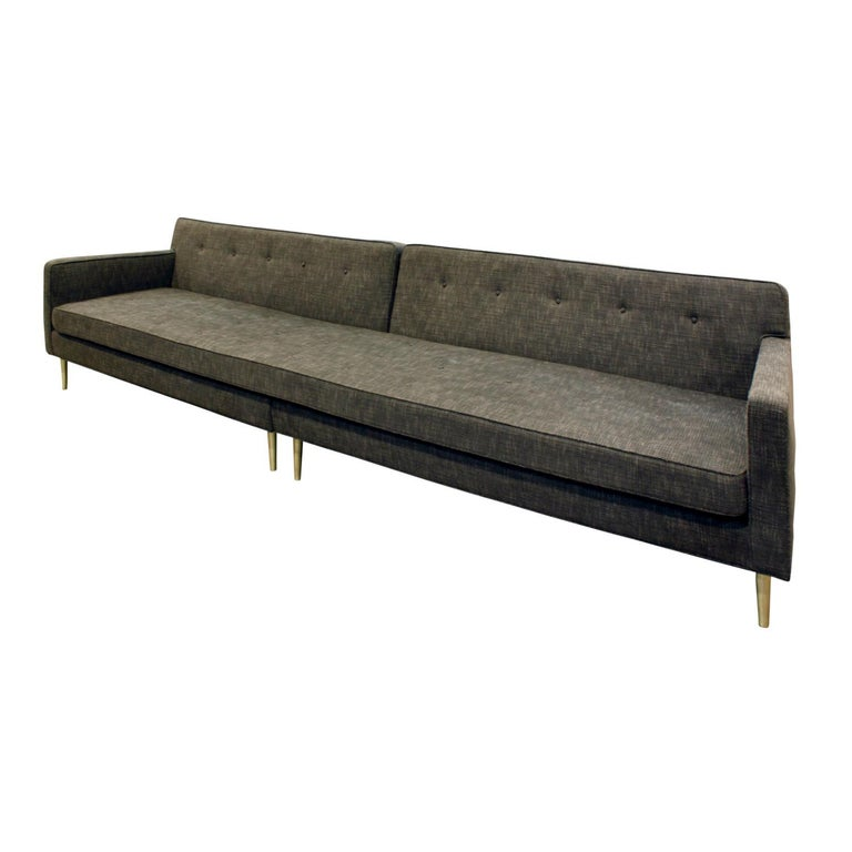 Clean-line sofa model no. 5125 with conical brass legs by Edward Wormley for Dunbar, American 1951 (retains original Dunbar label). This is a long version of this sofa which breaks down into two pieces so it can be easily moved in a small elevator.