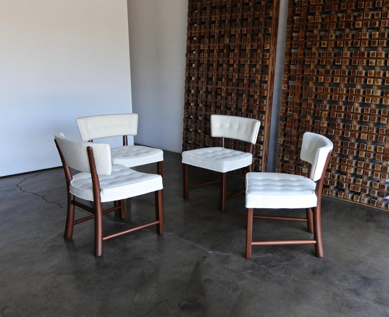 Edward Wormley dining chairs for Dunbar, circa 1957. This set has been professionally restored. Upholstered in holly hunt boucle. The listed price is for the set.