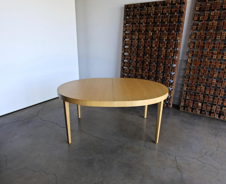 Edward Wormley bleached mahogany dining table for Dunbar, circa 1950. This piece has been professionally restored.  This table extends from 65.75