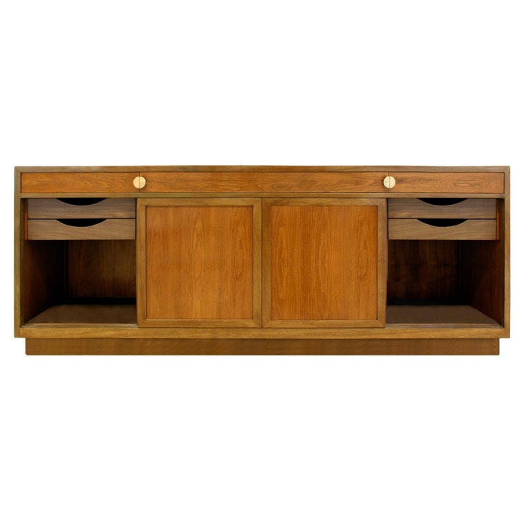 """Fine 4 door credenza in mahogany with walnut doors and brass """"D"""" pulls by Edward Wormley for Dunbar, American 1960's (signed in drawer). This piece is beautifully outfitted and meticulously crafted."""