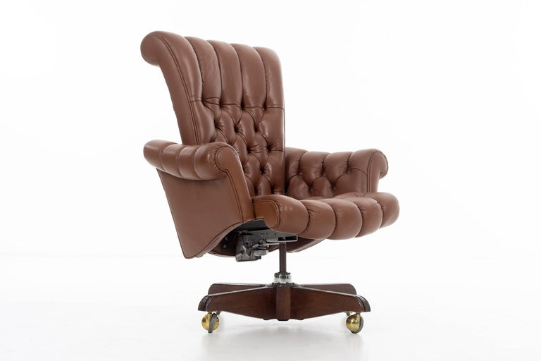 Wormley for Dunbar, high-back desk chair, model 932 diamond tufted button leather with scroll arms and back, tilt swivel, adjustable height, on solid walnut base with casters.