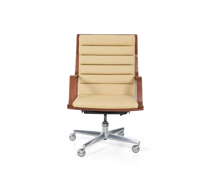 Wormley for Dunbar Desk chair, Channel seat and back Spinneybeck leather with mahogany woof frame, cast aluminum swivel base on 4 metal casters chairs.