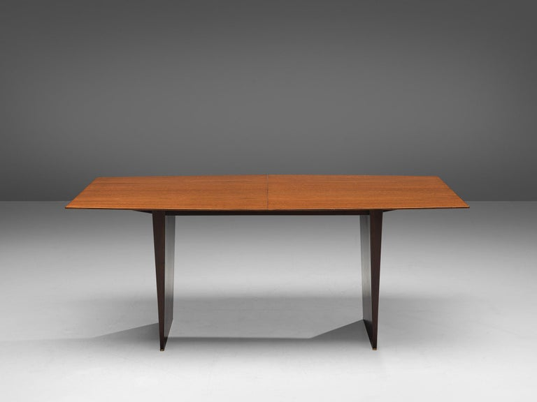 Edward Wormley extendable dining table in Tawi  Edward Wormley for Dunbar, dining table, tawi wood, The United States, 1960s  Wonderful boat-shaped dining table designed by Edward Wormley in the 1960s. The lacquered tabletop is made of tawi wood,