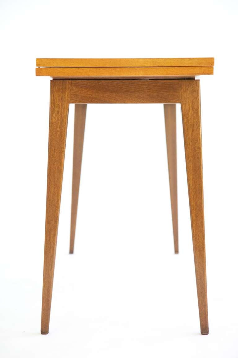 Wormley for Dunbar console table model 4911 also functions as dining table. Measures: Closed 17