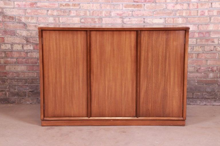 A sleek and stylish Mid-Century Modern elm wood sideboard server, credenza, or bar cabinet  By Edward Wormley for Drexel